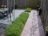 Aanleg tuin met natuursteen en gegalvaniseerde staalstrips